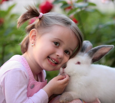 Compassionate girl and rabbit
